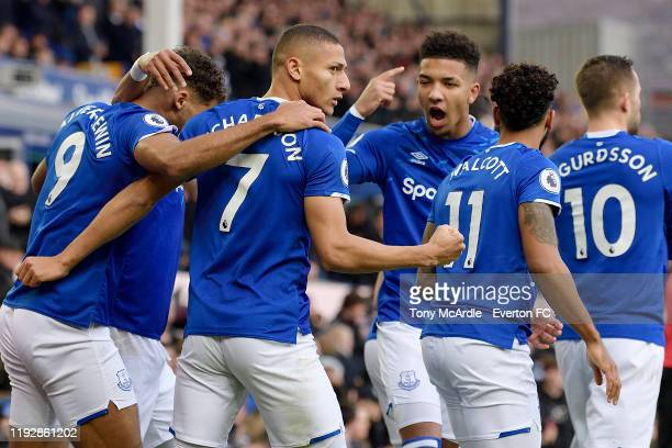 Richarlison of Everton celebrates his goal with Mason Holgate during the Premier League match between Everton and Chelsea at Goodison Park on...