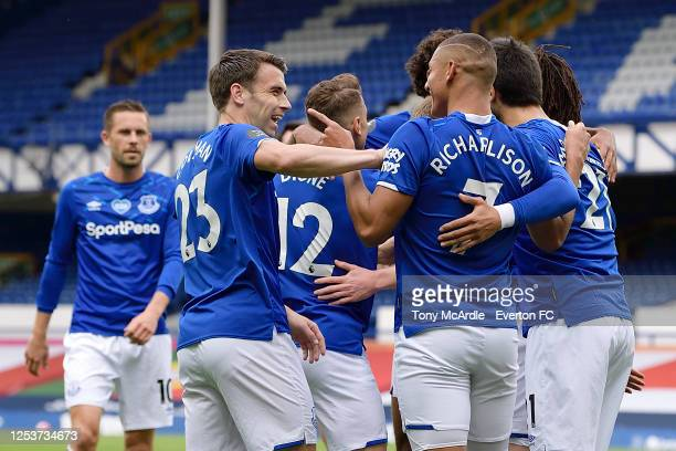 Richarlison of Everton celebrates his goal with Seamus Coleman during the Premier League match Everton and Leicester City at Goodison Park on July 1...