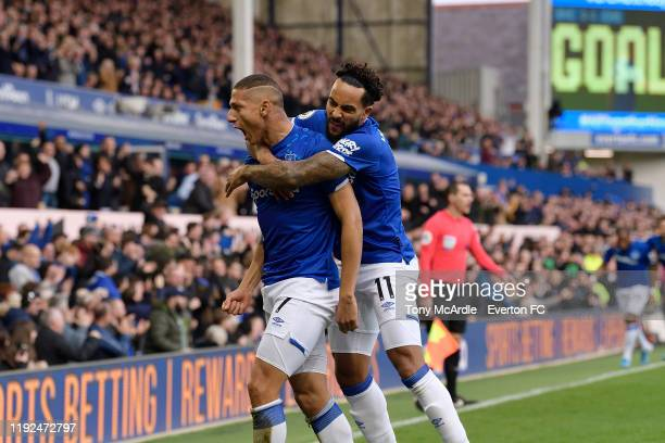 Richarlison of Everton celebrates his goal with Theo Walcott l during the Premier League match between Everton and Chelsea at Goodison Park on...