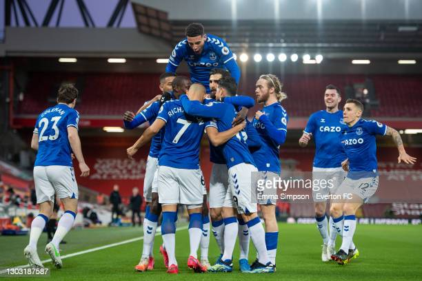Richarlison of Everton celebrates scoring his teams first goal with team mates during the Premier League match between Liverpool and Everton at...