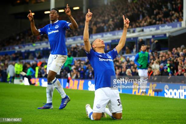 Richarlison of Everton celebrates scoring the opening goal during the Premier League match between Everton FC and Chelsea FC at Goodison Park on...