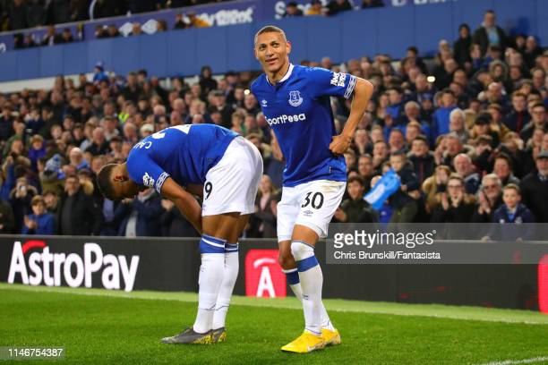 Richarlison of Everton celebrates scoring the opening goal during the Premier League match between Everton FC and Burnley FC at Goodison Park on May...