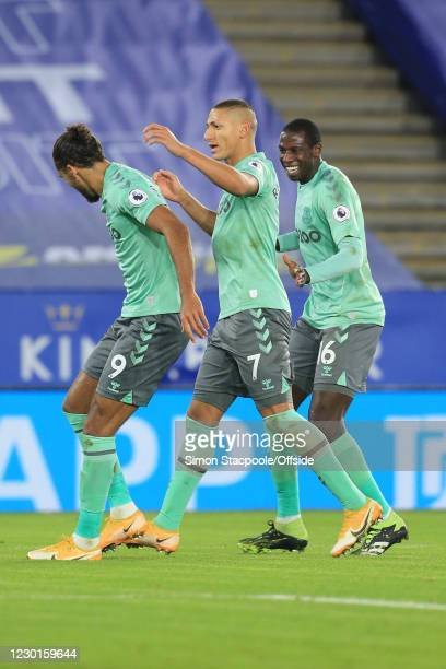 Richarlison of Everton celebrates scoring the opening goal with Dominic Calvert-Lewin and Abdoulaye Doucoure during the Premier League match between...