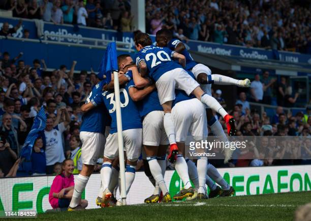 Richarlison of Everton celebrates with his team mates after scoring the first goal during the Premier League match between Everton FC and Manchester...