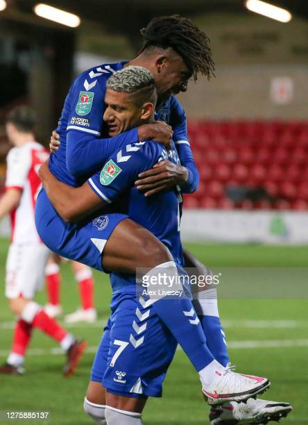 Richarlison of Everton celebrates with teammate Alex Iwobi after scoring his sides second goal during the Carabao Cup third round match between...