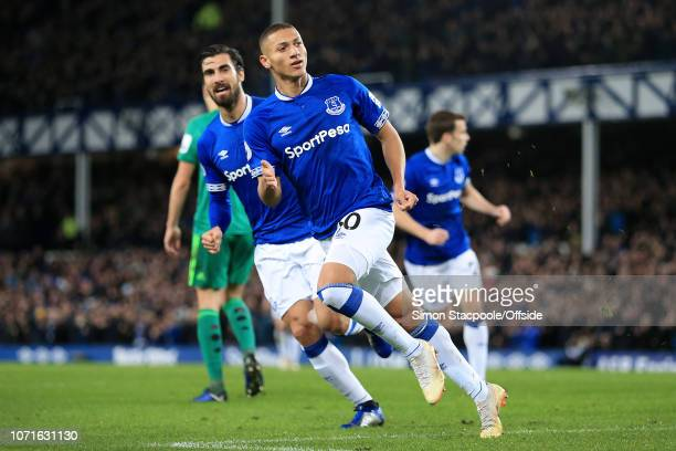 Richarlison of Everton celebrates with teammate Andre Gomes of Everton after scoring their 1st goal during the Premier League match between Everton...