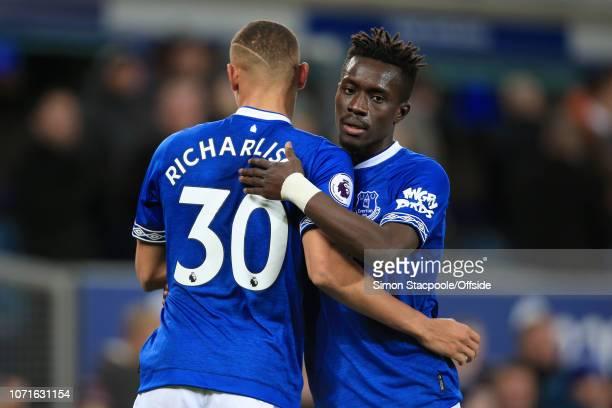 Richarlison of Everton celebrates with teammate Idrissa Gueye of Everton after scoring their 1st goal during the Premier League match between Everton...