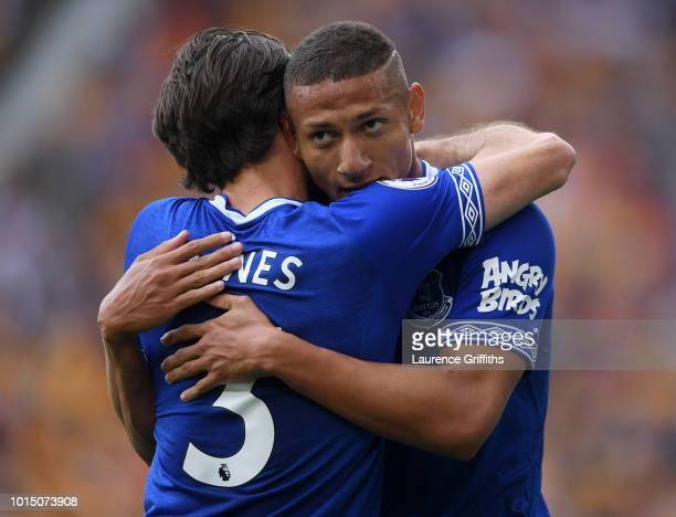 Richarlison of Everton celebrates with teammate Leighton Baines after scoring his team's first goal during the Premier League match between...