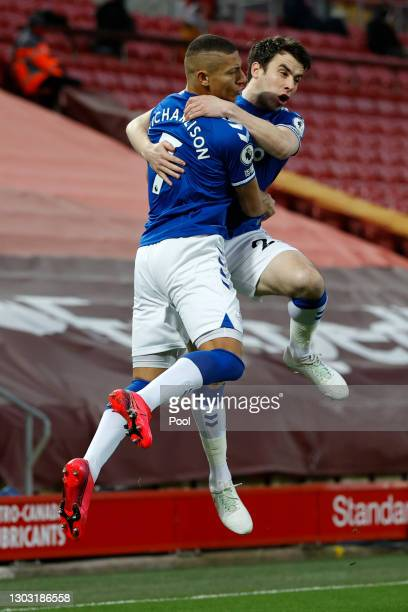 Richarlison of Everton celebrates with teammate Seamus Coleman after scoring his team's first goal during the Premier League match between Liverpool...