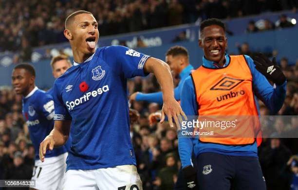 Richarlison of Everton celebrates with teammates after he scores his sides third goal during the Premier League match between Everton FC and Brighton...