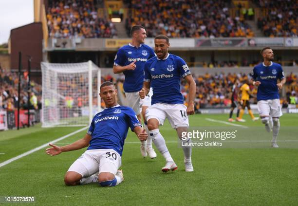Richarlison of Everton celebrates with teammates after scoring his team's first goal during the Premier League match between Wolverhampton Wanderers...