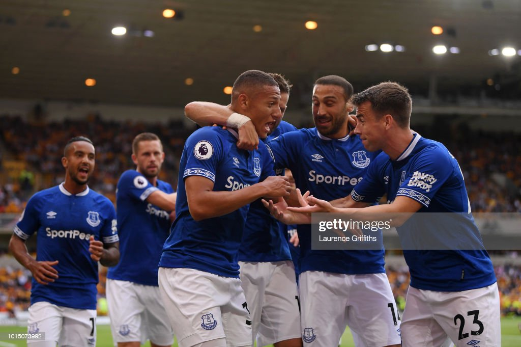 Richarlison of Everton celebrates with teammates after scoring his team's first goal during the Premier League match between Wolverhampton Wanderers and Everton FC at Molineux on August 11, 2018 in Wolverhampton, United Kingdom.