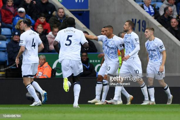 Richarlison of Everton celebrates with teammates after scoring his team's first goal during the Premier League match between Leicester City and...