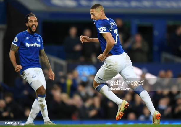 Richarlison of Everton celebrates with teammates after scoring his team's first goal during the Premier League match between Everton FC and Brighton...