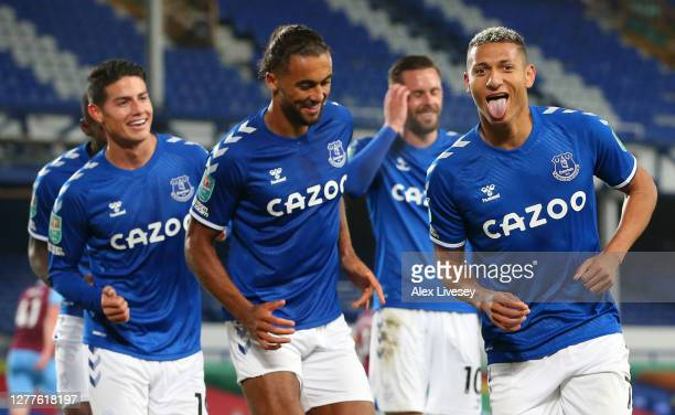 Richarlison of Everton celebrates with teammates after scoring his sides second goal during the Carabao Cup fourth round match between Everton and...