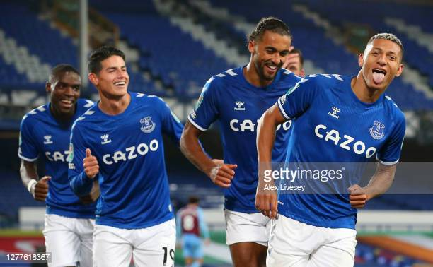 Richarlison of Everton celebrates with teammates Dominic Calvert-Lewin, James Rodriguez and Niels Nkounkou after scoring his sides second goal during...