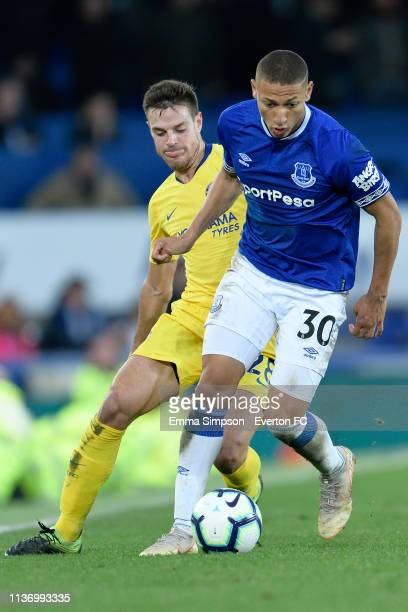 Richarlison of Everton challenges for the ball with Cesar Azpilicueta during the Premier League match between Everton and Chelsea at Goodison Park on...