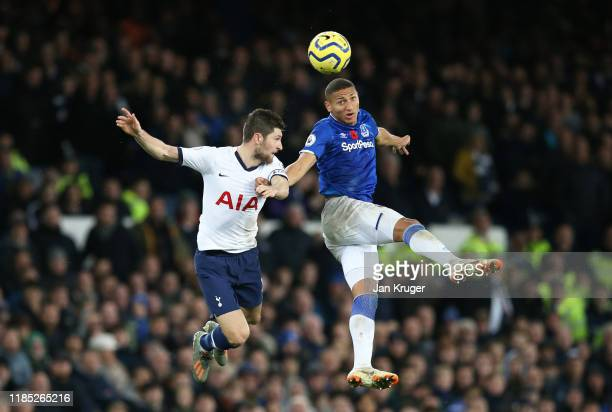 Richarlison of Everton challenges for the high ball with Ben Davies of Tottenham Hotspur during the Premier League match between Everton FC and...