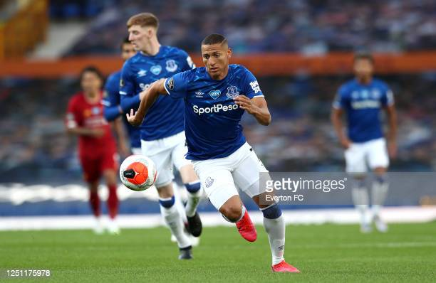 Richarlison of Everton controls the ball during the Premier League match between Everton FC and Liverpool FC at Goodison Park on June 21 2020 in...