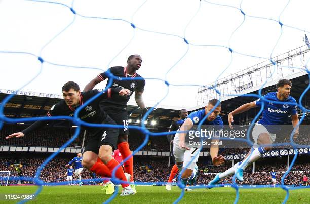 Richarlison of Everton falls to the ground after scoring his team's first goal during the Premier League match between Everton FC and Chelsea FC at...