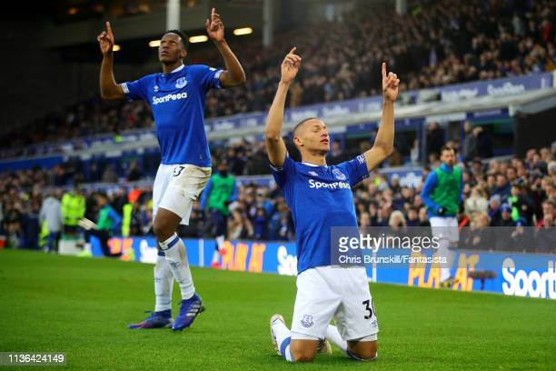 Richarlison of Everton FC celebrates scoring the opening goal during the Premier League match between Everton FC and Chelsea FC at Goodison Park on...
