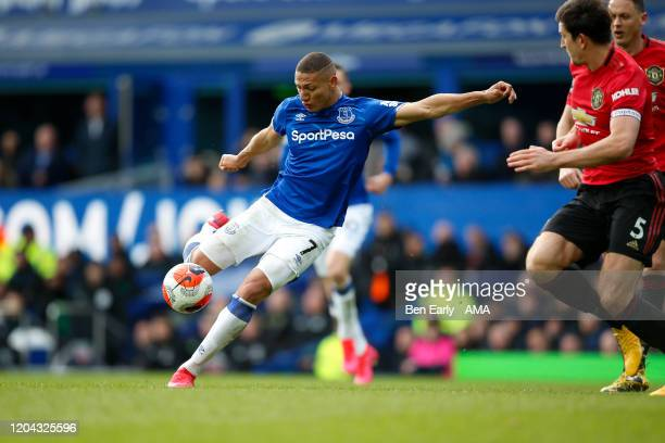 Richarlison of Everton FC takes a shot during the Premier League match between Everton FC and Manchester United at Goodison Park on March 1 2020 in...