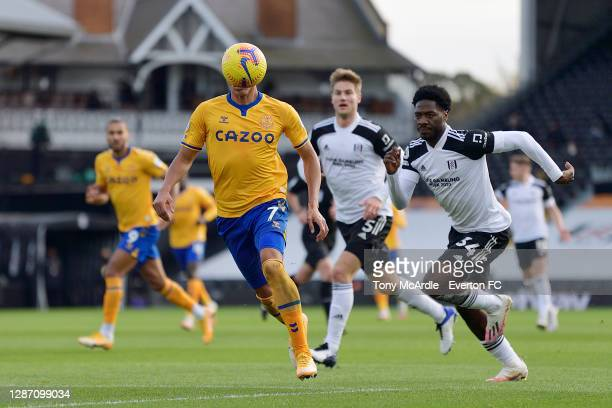 Richarlison of Everton has his face obscured by the ball as he challenges for the ball with Ola Aina during the Premier League match between Fulham...