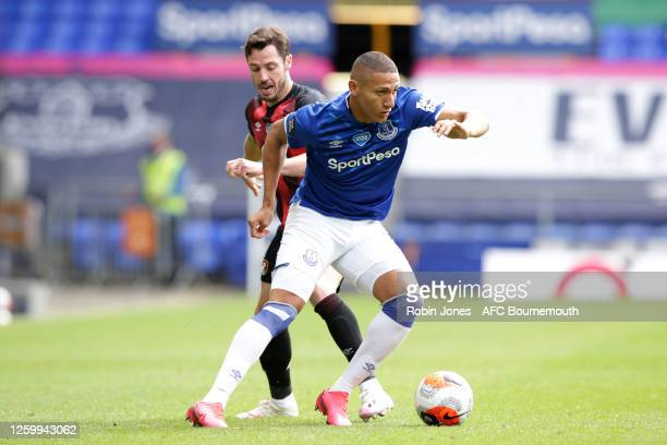 Richarlison of Everton holds off Adam Smith of Bournemouth during the Premier League match between Everton FC and AFC Bournemouth at Goodison Park on...