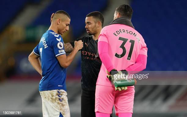 Richarlison of Everton interacts with Gabriel Jesus and Ederson of Manchester City during the Premier League match between Everton and Manchester...