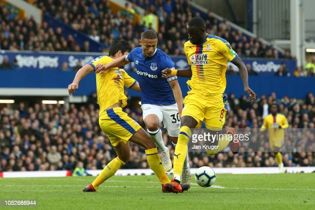 Richarlison of Everton is challanged by James Tomkins of Crystal Palace and Cheikhou Kouyate of Crystal Palace during the Premier League match...