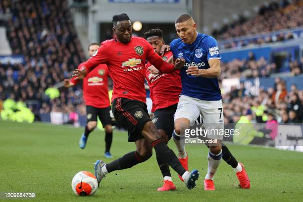Richarlison of Everton is challenged by Fred of Manchester United during the Premier League match between Everton FC and Manchester United at...