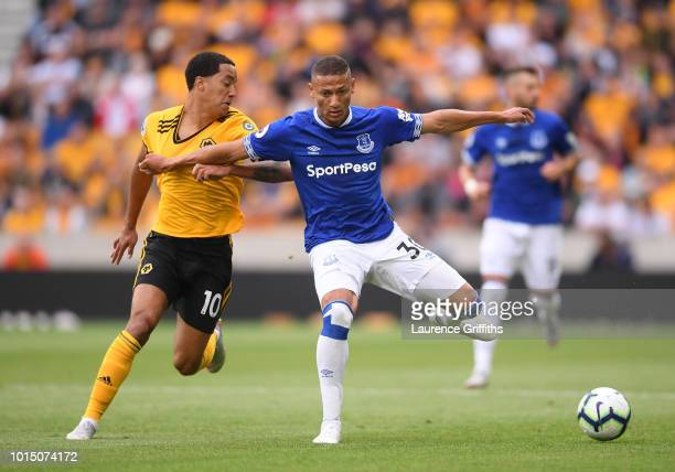 Richarlison of Everton is challenged by Helder Costa of Wolverhampton Wanderers during the Premier League match between Wolverhampton Wanderers and...