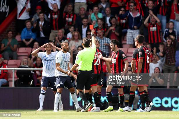 Richarlison of Everton is shown a red card by referee Lee Probert during the Premier League match between AFC Bournemouth and Everton FC at Vitality...