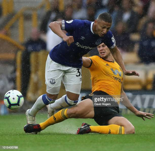 Richarlison of Everton is tackled by Ryan Bennett during the Premier League match between Wolverhampton Wanderers and Everton FC at Molineux on...