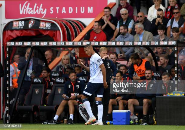 Richarlison of Everton leaves the pitch following receiving a red card during the Premier League match between AFC Bournemouth and Everton FC at...