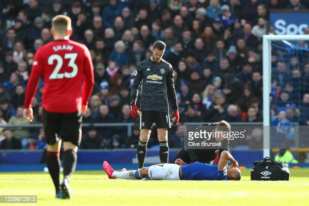 Richarlison of Everton receives treatment during the Premier League match between Everton FC and Manchester United at Goodison Park on March 01 2020...