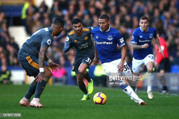 Richarlison of Everton runs with the ball during the Premier League match between Everton FC and Leicester City at Goodison Park on January 1 2019 in...