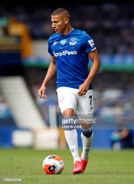 Richarlison of Everton runs with the ball during the Premier League match between Everton FC and AFC Bournemouth at Goodison Park on July 26 2020 in...