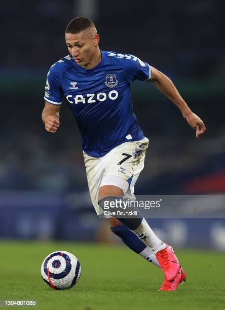 Richarlison of Everton runs with the ball during the Premier League match between Everton and Southampton at Goodison Park on March 01, 2021 in...