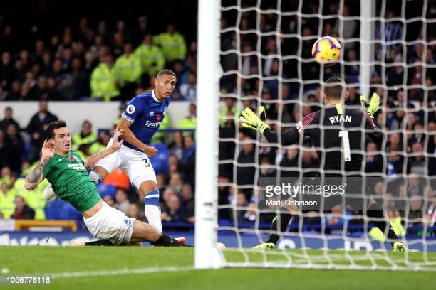 Richarlison of Everton scores his sides first goal during the Premier League match between Everton FC and Brighton Hove Albion at Goodison Park on...