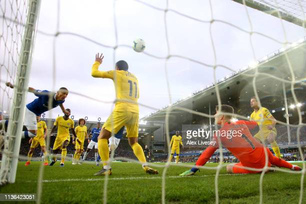 Richarlison of Everton scores his sides first goal during the Premier League match between Everton FC and Chelsea FC at Goodison Park on March 17...