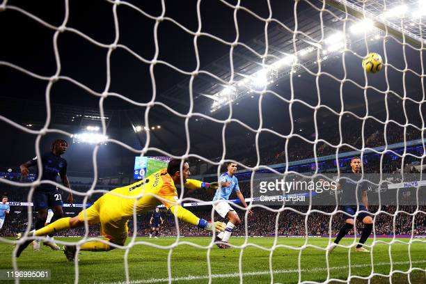 Richarlison of Everton scores his sides first goal past Claudio Bravo of Manchester City during the Premier League match between Manchester City and...
