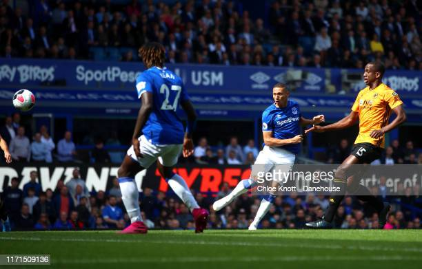 Richarlison of Everton scores his teams first goal during the Premier League match between Everton FC and Wolverhampton Wanderers at Goodison Park on...