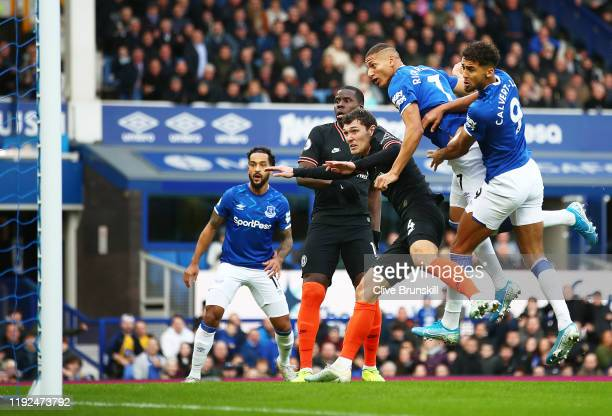 Richarlison of Everton scores his team's first goal during the Premier League match between Everton FC and Chelsea FC at Goodison Park on December 07...