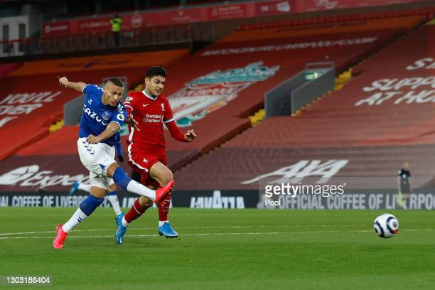 Richarlison of Everton scores his team's first goal during the Premier League match between Liverpool and Everton at Anfield on February 20, 2021 in...
