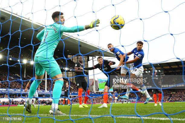 Richarlison of Everton scores his team's first goal past Kepa Arrizabalaga of Chelsea during the Premier League match between Everton FC and Chelsea...