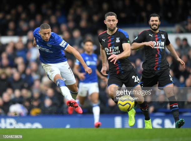 Richarlison of Everton scores his team's second goal during the Premier League match between Everton FC and Crystal Palace at Goodison Park on...