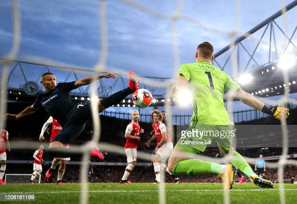 Richarlison of Everton scores his team's second goal past Bernd Leno of Arsenal during the Premier League match between Arsenal FC and Everton FC at...
