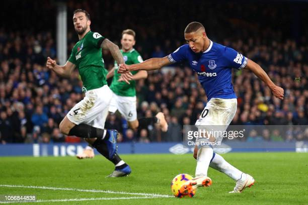 Richarlison of Everton scores his team's third goal during the Premier League match between Everton FC and Brighton Hove Albion at Goodison Park on...