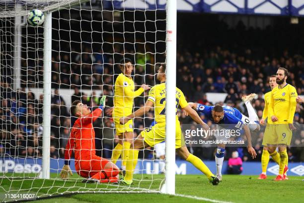 Richarlison of Everton scores the opening goal during the Premier League match between Everton FC and Chelsea FC at Goodison Park on March 17 2019 in...